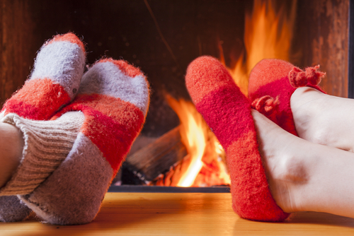 Slippers on table in front of fire