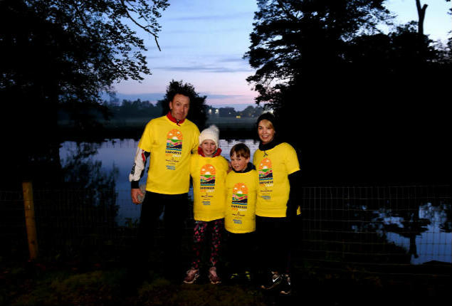 Family walking from Darkness Into Light