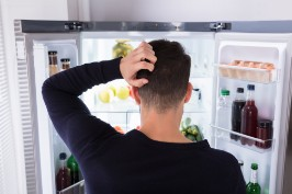 Man looking into fridge